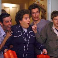 Photo - MOVIE: SB-210 : Seth (Jonah Hill, center left) and Evan (Michael Cera, right) can have the night they'll remember for the rest of their lives in