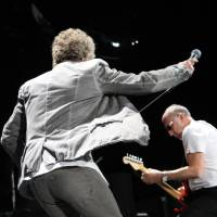 Photo - Roger Daltrey goes airborne while performing with The Who on Thursday at the BOK Center in Tulsa. PHOTO BY VERNON GOWDY III, FOR THE OKLAHOMAN