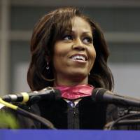 Photo - First lady Michelle Obama delivers the commencement address to graduates of Martin Luther King, Jr. Academic Magnet High School on Saturday, May 18, 2013, in Nashville, Tenn. (AP Photo/Mark Humphrey)
