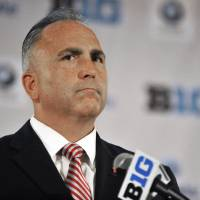 Photo - Rutgers head coach Kyle Flood talks to the media during the Big Ten Football Media Day in Chicago, Monday, July 28, 2014. (AP Photo/Paul Beaty)