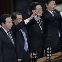 Photo -   Prime Minister Yoshihiko Noda stands with Chief Cabinet Secretary Osamu Fujimura, second left, and Foreign Minister Koichiro Gemba, right, after he dissolved the lower house of parliament in Tokyo Friday, Nov. 16, 2012. Noda dissolved the lower house of parliament Friday, paving the way for elections in which his ruling party will likely give way to a weak coalition government divided over how to solve Japan's myriad problems. (AP Photo/Koji Sasahara)