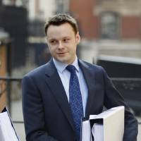 Photo -   Adam Smith, former special adviser to Culture Secretary Jeremy Hunt arrives at the Leveson inquiry, in central London, Thursday, May 24, 2012. Smith, who resigned last month after saying he went too far over his e-mail contacts relating to News Corporation's bid to take over BSkyB, was due to give evidence to the Leveson Inquiry into media standards. Hunt has rejected Labour party calls to quit over claims his relationship with Rupert Murdoch's company was too close. (AP Photo/Lefteris Pitarakis)