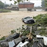 14 dead in West Virginia floods; focus on search and rescue