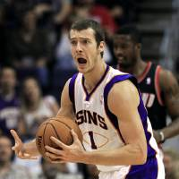Photo -   Phoenix Suns' Goran Dragic (1), of Slovenia, argues with an official after being called for a foul during the first half of an NBA preseason basketball game against the Portland Trail Blazers on Friday, Oct. 12, 2012, in Phoenix.(AP Photo/Ross D. Franklin)