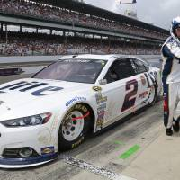 Photo - Brad Keselowski pits during the Brickyard 400 auto race at Indianapolis Motor Speedway in Indianapolis, Sunday, July 27, 2014. (AP Photo/R Brent Smith)