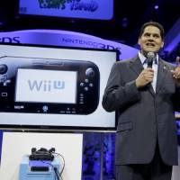 Photo - FILE - In this June 11, 2013 file photo, Reggie Fils-Aime, President and chief operating officer of Nintendo of America, addresses the media at the Nintendo Wii U software showcase during the E3 game show in Los Angeles. After the launch of Sony's PlayStation 4, Microsoft's Xbox One and Nintendo's Wii U consoles, a combination of both original creations and the latest installments in long-running series will be a major focus at this year's Electronic Entertainment Expo held June 10-12, 2014, in Los Angeles. (AP Photo/Jae C. Hong, file)