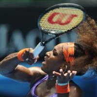 Photo - Serena Williams of the US hits a forehand return to Spain's Garbine Muguruza during their second round match at the Australian Open tennis championship in Melbourne, Australia, Thursday, Jan. 17, 2013. (AP Photo/Andrew Brownbill)