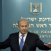 Photo -   FILE - In this Feb. 22, 2012 file photo, Israeli Prime Minister Benjamin Netanyahu gives a press conference at the Prime Minister's office in Jerusalem. Signs are growing that Israeli Prime Minister Benjamin Netanyahu will soon call parliamentary elections months ahead of schedule, seeking to capitalize on a wave of popularity and a fragmented opposition to guarantee his hold on power for several more years. While Netanyahu has not made any formal announcement, a number of members of his coalition, including his foreign minister and the speaker of parliament, have signaled that elections are imminent. An official decision could come in the next week or two as parliament opens its fall session, with February the likely date of the vote.(AP Photo/Bernat Armangue, File)