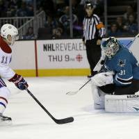 Photo - San Jose Sharks goalie Antti Niemi (31), of Finland, stops a shot from Montreal Canadiens right wing Brendan Gallagher (11) during the second period of an NHL hockey game Saturday, March 8, 2014, in San Jose, Calif. (AP Photo/Tony Avelar)