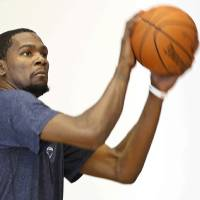 Photo - Oklahoma City Thunder forward Kevin Durant (35) shoots extra baskets following a team practice in Oklahoma City, Monday, April 28, 2014. The Thunder face the Memphis Grizzlies in Game 5 of the first round of the NBA basketball playoffs on Tuesday. (AP Photo)