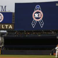 Photo - New York Yankees players observe a moment of silence in memory of the victims of the Boston Marathon explosions before a baseball game against the Arizona Diamondbacks at Yankee Stadium in New York, Tuesday, April 16, 2013. (AP Photo/Kathy Willens)