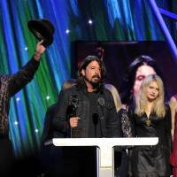 Photo - Hall of Fame Inductee of Nirvana, Dave Grohl speaks at the 2014 Rock and Roll Hall of Fame Induction Ceremony on Thursday, April, 10, 2014 in New York. (Photo by Charles Sykes/Invision/AP)
