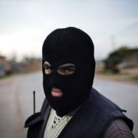 Photo - A Kurdish member of the FSA is seen at a check point in Fafeen village, north of Aleppo province, Syria, Wednesday, Dec 12, 2012 (AP Photo / Manu Brabo)