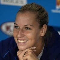 Photo - Dominika Cibulkova of Slovakia listens to a reporter's question after her loss in the women's singles final against Li Na of China at the Australian Open tennis championship in Melbourne, Australia, Saturday, Jan. 25, 2014. (AP Photo/Andrew Brownbill)