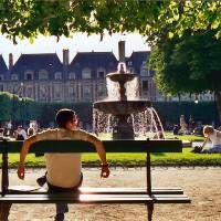Photo - Parisians makes good use of their handsome parks in the summer months.  (photo: Carol Ries)