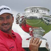 Photo - Graeme McDowell of Northern Ireland poses with his trophy after winning the French Open Golf tournament at Paris National course in Guyancourt, west of Paris, France, Sunday, July 6, 2014. (AP Photo/Francois Mori)