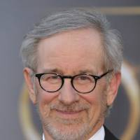 Photo - FILE - In this Feb. 24, 2013 file photo, director Steven Spielberg arrives at the Oscars at the Dolby Theatre in Los Angeles. Spielberg has his sights set on his next film. A spokeswoman for DreamWorks Studios said Thursday, May 2, 2013,  the filmmaker plans to direct Bradley Cooper in an adaptation of the best-selling book