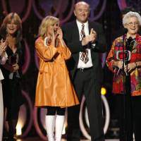 Photo - FILE - In this April 14, 2007, file photo, Florence Henderson, from left, Susan Olsen, Maureen McCormick, Lloyd Schwartz and Ann B. Davis of the television show