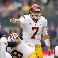 Photo -   Southern California quarterback Matt Barkley directs his team against Washington during the first half of an NCAA college football game Saturday, Oct. 13, 2012, in Seattle. (AP Photo/Elaine Thompson)