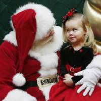 Photo - MALL SANTA CLAUS / CHILD / CHILDREN: Santa Claus touches Sienna Smithson's  cheek, trying to make the 2-year-old smile while having their picture made  at Penn Square Mall Friday afternoon, Dec. 12, 2008. Smithson is from Yukon.  This Santa, who gave his name as