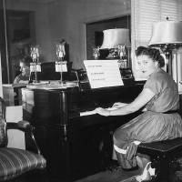 Photo - SIEBER HOTEL: Del Rose Sieber plays piano in the sixth floor apartment that was her family's home. PHOTO PROVIDED BY MARVA ELLARD     ORG XMIT: 0901282222058157