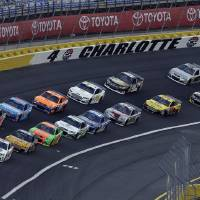 Photo - Drivers navigate Turn 4 as they approach the start of the NASCAR Sprint Showdown auto race at the Charlotte Motor Speedway in Concord, N.C., Friday, May 16, 2014. (AP Photo/Gerry Broome)