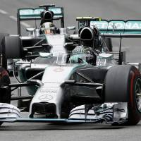 Photo - Mercedes driver Nico Rosberg of Germany leads his teammate Mercedes driver Lewis Hamilton of Britain during the Monaco Formula One Grand Prix, at the Monaco racetrack, in Monaco, Sunday, May 25, 2014. (AP Photo/Luca Bruno)