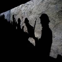 Photo - Silhouettes of British soldiers are projected onto a trench scene in the new