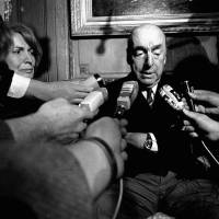 Photo - FILE - This Oct. 21, 1971 file photo shows Pablo Neruda, poet and then Chilean ambassador to France, talking with reporters in Paris after being named the 1971 Nobel Prize for Literature. Forensic experts say no traces of chemical agents have been found in Neruda's bone remains. Chile's Communist Party asked to exhume his remains following allegations he may have been poisoned. Officially, Neruda died of cancer only days after the 1973 coup toppled his close friend, President Salvador Allende. His body was exhumed in April 2013. (AP Photo/Laurent Rebours, File)