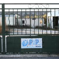 Photo - FOR STORY BRITAIN COSMETIC SURGERY - FILE - In this Friday, Jan. 6, 2012, file photo showing the closed gate of the entrance to Poly Implant Prothese, PIP factory in La Seyne-sur-Mer, southern France. An independent expert group released a report Wednesday April 24, 2013, which slammed Britain's cosmetic surgery industry for not protecting patients adequately and is calling for stricter controls in the aftermath of a breast implant scandal in Europe last year that left tens of thousands of women with cheap silicone implants which are allegedly prone to ruptures. The expert group, commissioned by the U.K. Department of Health, also called for the creation of a registry of implants and other medical devices. (AP Photo/Claude Paris, File)