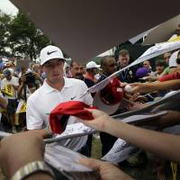 Photo - Rory McIlroy, of Northern Ireland, signs autographs after a practice round for the PGA Championship golf tournament at Valhalla Golf Club on Tuesday, Aug. 5, 2014, in Louisville, Ky. The tournament is set to begin on Thursday. (AP Photo/David J. Phillip)
