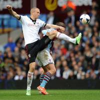 Photo - Aston Villa's Grant Holt, rear, and Fulham's Brede Hangeland battle for the ball during the English Premier League soccer match at Villa Park, Birmingham, England, Saturday April 5, 2014. (AP Photo/PA, Joe Giddens) UNITED KINGDOM OUT  NO SALES  NO ARCHIVE