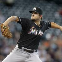 Photo - Miami Marlins pitcher Brad Hand throws during the first inning of a baseball game against the Houston Astros, Friday, July 25, 2014, in Houston. (AP Photo/Patric Schneider)