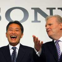 Photo -   FILE - In this Feb. 2, 2012 file photo, Sony Corp. President and Chief Executive Officer to be Kazuo Hirai, left, and outgoing CEO Howard Stringer have a light moment following their press conference in Tokyo. Sony now has a new president - Hirai, the former head of its game division. But shareholders are already raising doubts about his ability to revive the Japanese electronics and entertainment giant. (AP Photo/Junji Kurokawa, File)
