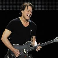 """Photo -   FILE - This June 1, 2012 file photo shows guitarist Eddie Van Halen of the band Van Halen performing in Los Angeles. Van Halen underwent an emergency surgery for the digestive disease diverticulitis and is canceling his tour in Japan to recover. His representative said Thursday, Aug. 30, that Van Halen had """"a severe bout of diverticulitis"""" and is expected to recover in four to six months. Diverticulitis is a painful condition that involves the formation of pouches on the outside of the colon. (Photo by Chris Pizzello/Invision/AP, file)"""