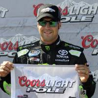 Photo - Sam Hornish Jr. holds the pole position flag after qualifying for the NASCAR Nationwide Series Nationwide Children's Hospital 200 auto race at Mid-Ohio Sports Car Course on Saturday, Aug. 16, 2014 in Lexington, Ohio. (AP Photo/Tom E. Puskar)