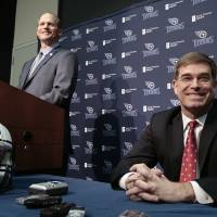 Photo - Tennessee Titans head coach Ken Whisenhunt, left, answers questions at a news conference with general manager Ruston Webster, right, Tuesday, Jan. 14, 2014, in Nashville, Tenn. The Titans introduced Whisenhunt Tuesday as their 17th head coach and only their third different coach since moving from Houston to Tennessee. (AP Photo/Mark Humphrey)