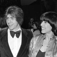 Photo -   FILE - This Feb. 22, 1978 file photo shows screenwriter Nora Ephron, right, with her husband journalist and author Carl Bernstein in New York. Oscar-nominated filmmaker and author Nora Ephron is very ill, according to a representative for her publisher. Nicholas Latimer of Alfred A. Knopf confirmed her condition on Tuesday, June 26, 2012, hours after celebrity columnist and friend Liz Smith published what appeared to be a memorial for the writer. Smith told The Associated Press that she had spoken to Ephron's son Tuesday morning and was told that Ephron was dying. She said when she heard that funeral plans had already been arranged, she published the column on the website Women on the Web. Latimer did not provide any additional information on Ephron's condition. (AP Photo/Richard Drew, file)