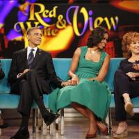 "Photo -   President Barack Obama and first lady Michelle Obama appear on the ABC Television show ""The View"" in New York, Monday, Sept. 24, 2012, From left are, Barbara Walters, president and first lady, Joy Behar, and Sherri Shepherd. (AP Photo/Pablo Martinez Monsivais)"