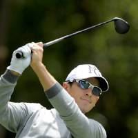 Photo - Scott Langley hits off the ninth tee during the first round of the RBC Heritage golf tournament in Hilton Head Island, S.C., Thursday, April 17, 2014. (AP Photo/Stephen B. Morton)