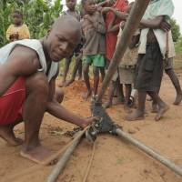 Photo - An African man works to obtain water through a Water4 Foundation project. The Oklahoma City-based nonprofit is hosting its first Pioneering Spirit Gala on Sept. 27 in Oklahoma City. Photo provided