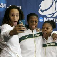Photo - From left, Baylor's Brittney Griner, Brooklyn Pope and Odyssey Sims, right, pose for a self portrait on the stage after a news conference following their second-round game against Florida State in the women's NCAA college basketball tournament, Tuesday, March 26, 2013, in Waco, Texas. Baylor won 85-47. (AP Photo/Tony Gutierrez)