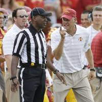 Photo - Iowa State head coach Paul Rhoads, right, reacts to a call against his team during the first half of an NCAA college football game against the North Dakota State, Saturday, Aug. 30, 2014, in Ames, Iowa. (AP Photo/Charlie Neibergall)