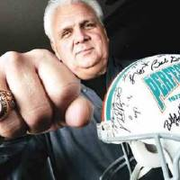 Photo -   In this 2005 photo, former Miami Dolphins and University of Oklahoma football player Jim Riley is shown with his Super Bowl ring and an autographed helmet from a perfect season with the Miami Dolphins. PHOTO BY BRYAN TERRY, THE OKLAHOMAN ARCHIVES