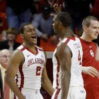 Photo -  Oklahoma's Steven Pledger (2) and Andrew Fitzgerald (4) celebrate during the Bedlam men's college basketball game between the University of Oklahoma Sooners and the Oklahoma State Cowboys in Norman, Okla., Wednesday, Feb. 22, 2012. Oklahoma won 77-64. Photo by Bryan Terry, The Oklahoman
