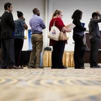 Photo - In this June 23, 2014 photo, job seekers wait in line to meet with recruiters during a job fair in Philadelphia. The government issues the July jobs report on Friday, Aug. 1, 2014. (AP Photo/Matt Rourke)