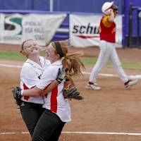 Photo - HIGH SCHOOL SOFTBALL TOURNAMENT / CELEBRATION: Wayne's Michal Hylton, left, and Chloe Clifton (4) celebrate the win during the Oklahoma State Softball tournament game between Wayne and Dale at ASA Hall of Fame Stadium on Thursday, Oct. 4, 2012, in Oklahoma City, Okla.   Photo by Chris Landsberger, The Oklahoman