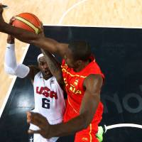 Photo - United States'  LeBron James (6) drives to the basket against Spain's Serge Ibaka during the men's gold medal basketball game at the 2012 Summer Olympics  in London on Sunday, Aug. 12, 2012. (AP Photo/Christian Petersen, Pool)