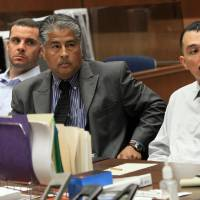 Photo - FILE - In this May 31, 2012 file photo, Marvin Norwood , left, with attorney Victor Escobedo, center, and co-defendant Louie Sanchez appear during a preliminary hearing held in Los Angeles Superior court. The two men have pleaded guilty on Thursday, Feb. 20, 2014 in Los Angeles to a 2011 beating at Dodger Stadium that left San Francisco Giants fan Bryan Stow brain damaged and disabled. (AP Photo/Los Angeles Times, Irfan Khan, Pool, File)