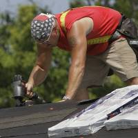 Photo -  Construction worker Tony Elshoff installs roofing tile in 100 degree temperatures Tuesday, July 17, 2012 in Springfield, Ill. Along with the unrelenting heat wave, the nation's widest drought in decades is spreading. More than half of the continental U.S. is now in some stage of drought, and most of the rest is abnormally dry. (AP Photo/Seth Perlman)